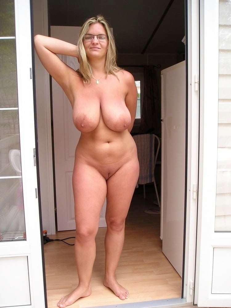 Big tits mom laying naked on her bed flaunting those huge natural tits