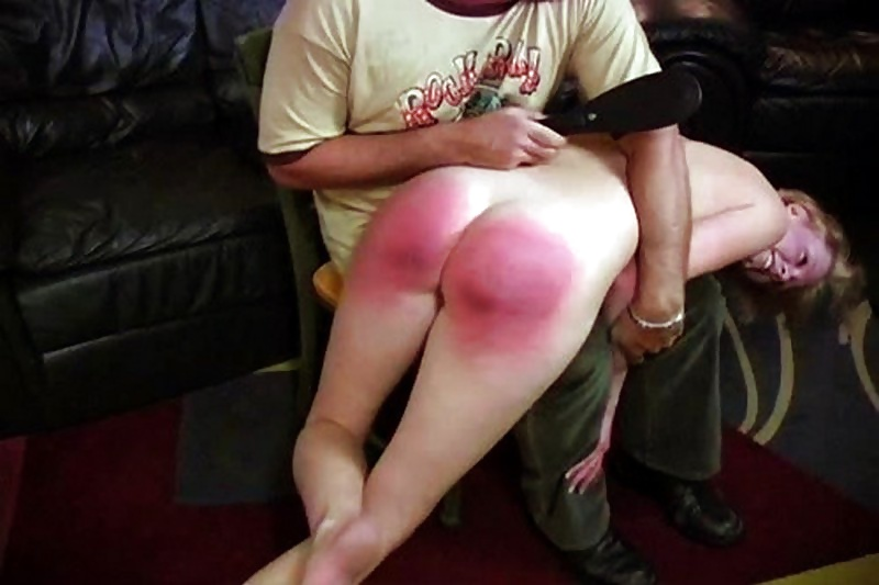 Oiled bottom spanking