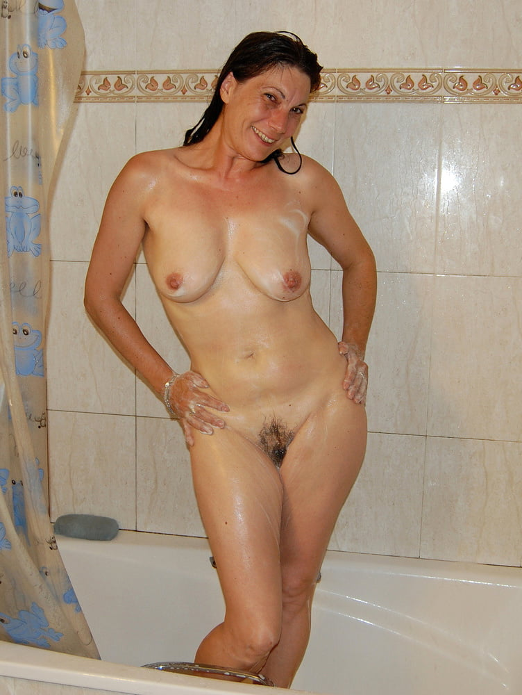Curvy housewife before she takes a shower