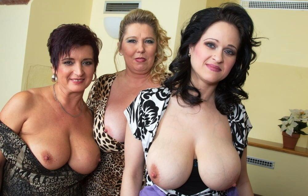 Three mature women working with laptop