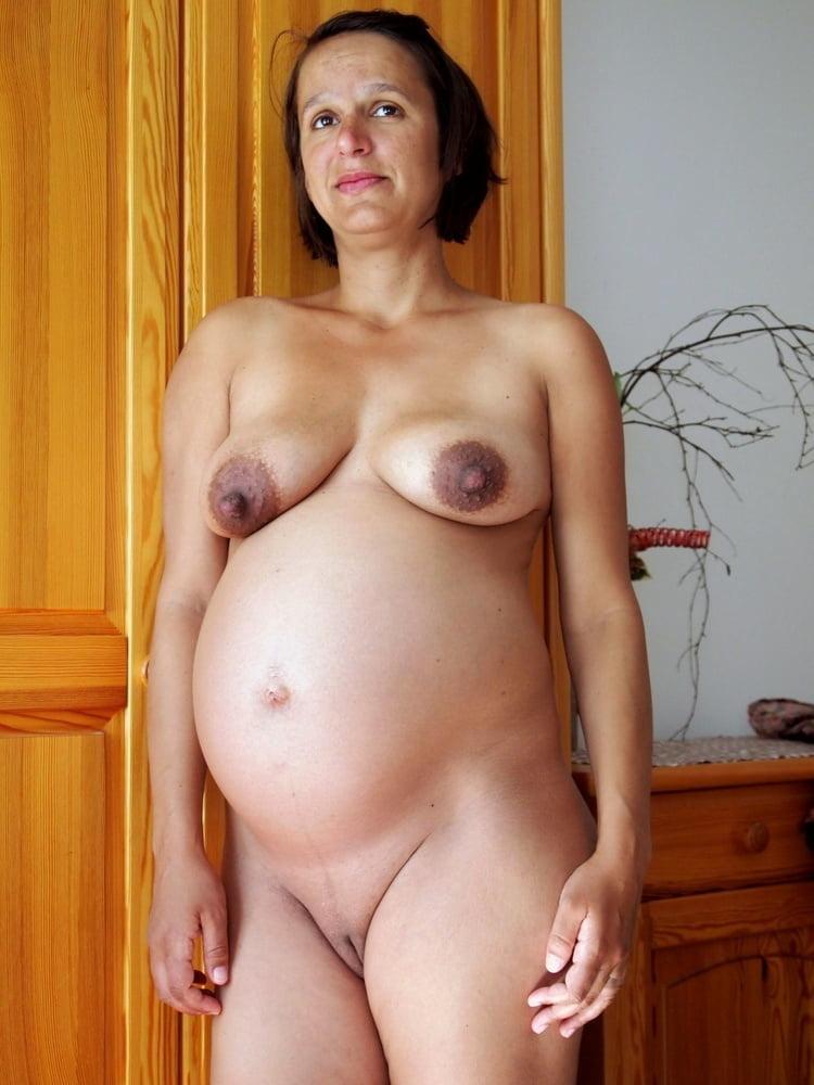 Pregnant woman by lake stock photo