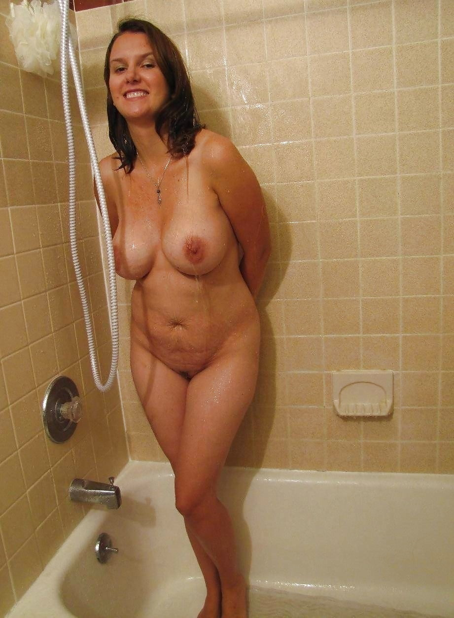 Nude housewives in showers — pic 12