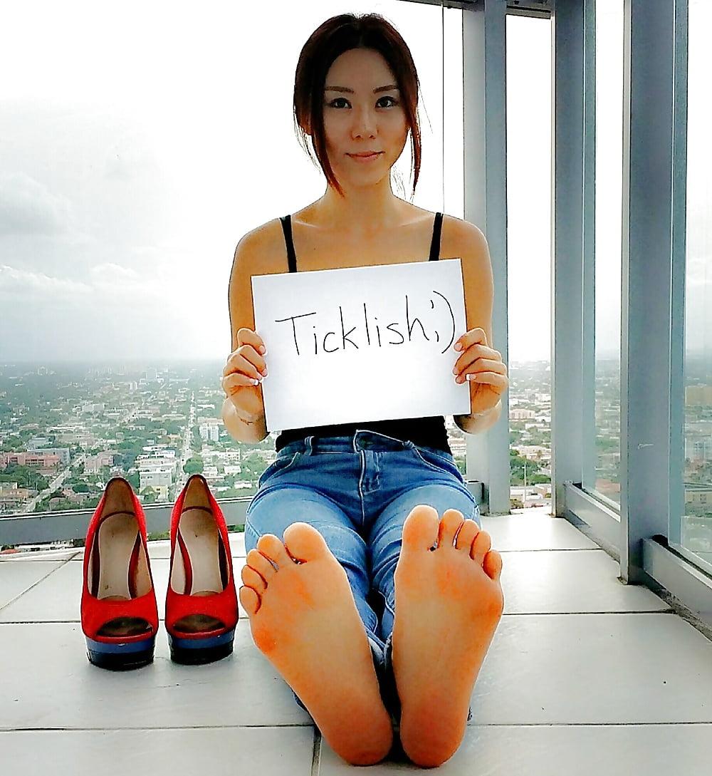 Barefoot sexy asian girl