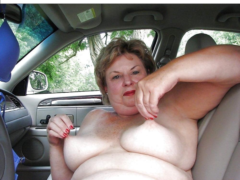 Sexy girl removing her bra