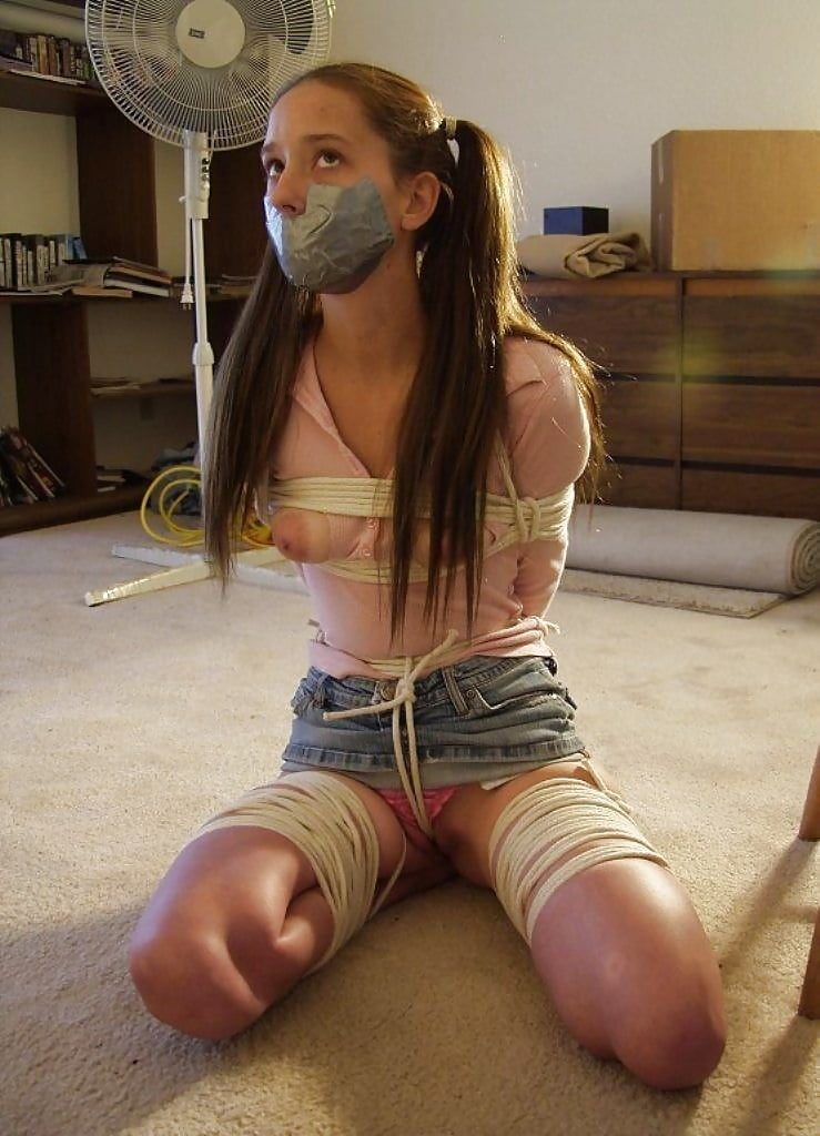 Girl tied up topless, spandex yoga teen