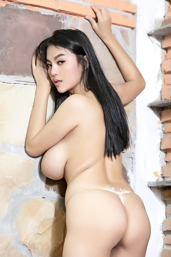 Mature big tits thai