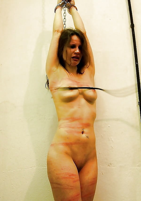 Naked female pillory whipping