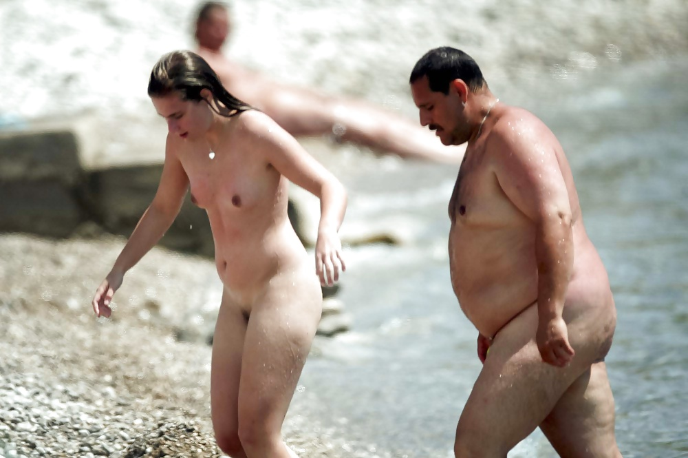 Father and daughter at nude beach together