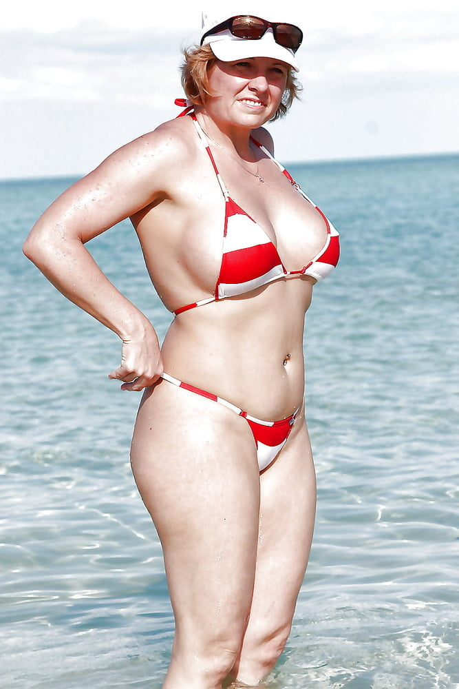 Older woman in bikini high resolution stock photography and images
