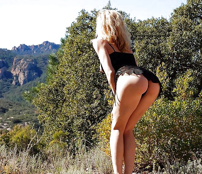 Slim Blonde Showing Off Her Sexy Legs While Scaling The Mountain Tits Guru 1