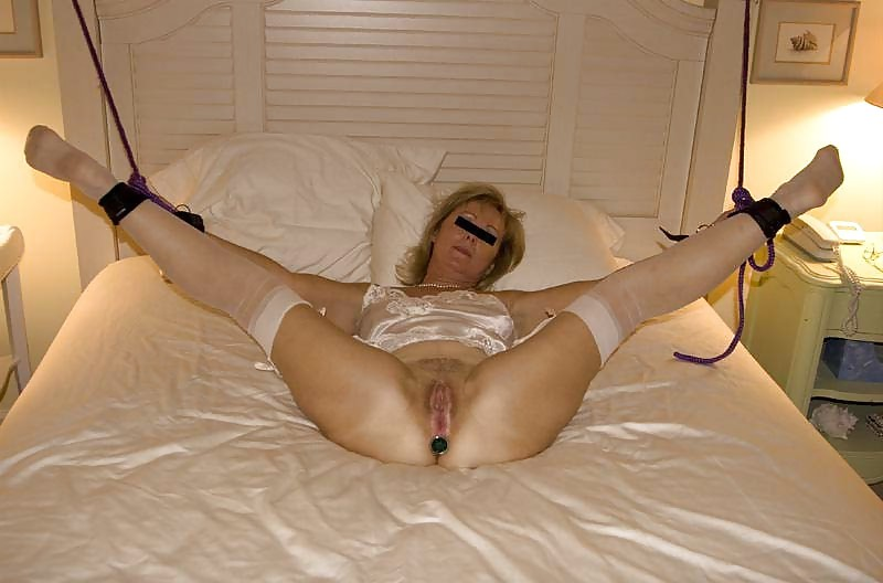 Big Mature Tied To A Bed