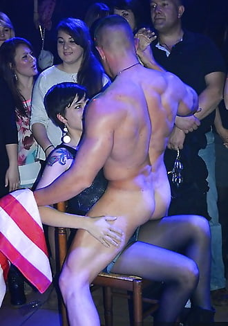 Male stripper forcefully removing girls panties on stage