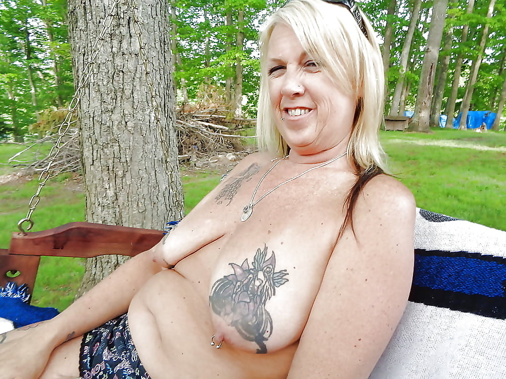 Mature Tattooed Hipster Woman Leaning On Boyfriends Shoulder Cool, Outdoors