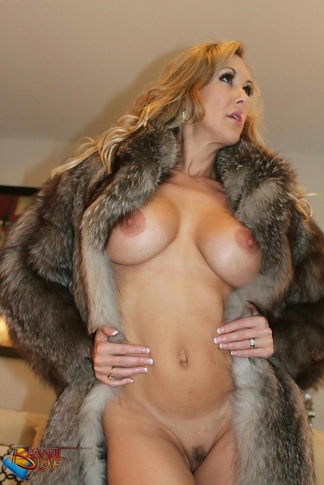 Busty Topless Teen In Fur Coat Dessert Picture