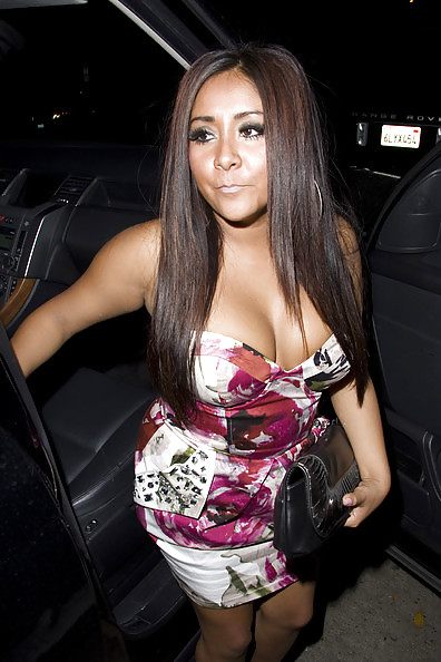 Snooki shows off her bigger breasts to jwoww one week after getting a boob job