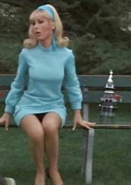 Topless women in mini skirts