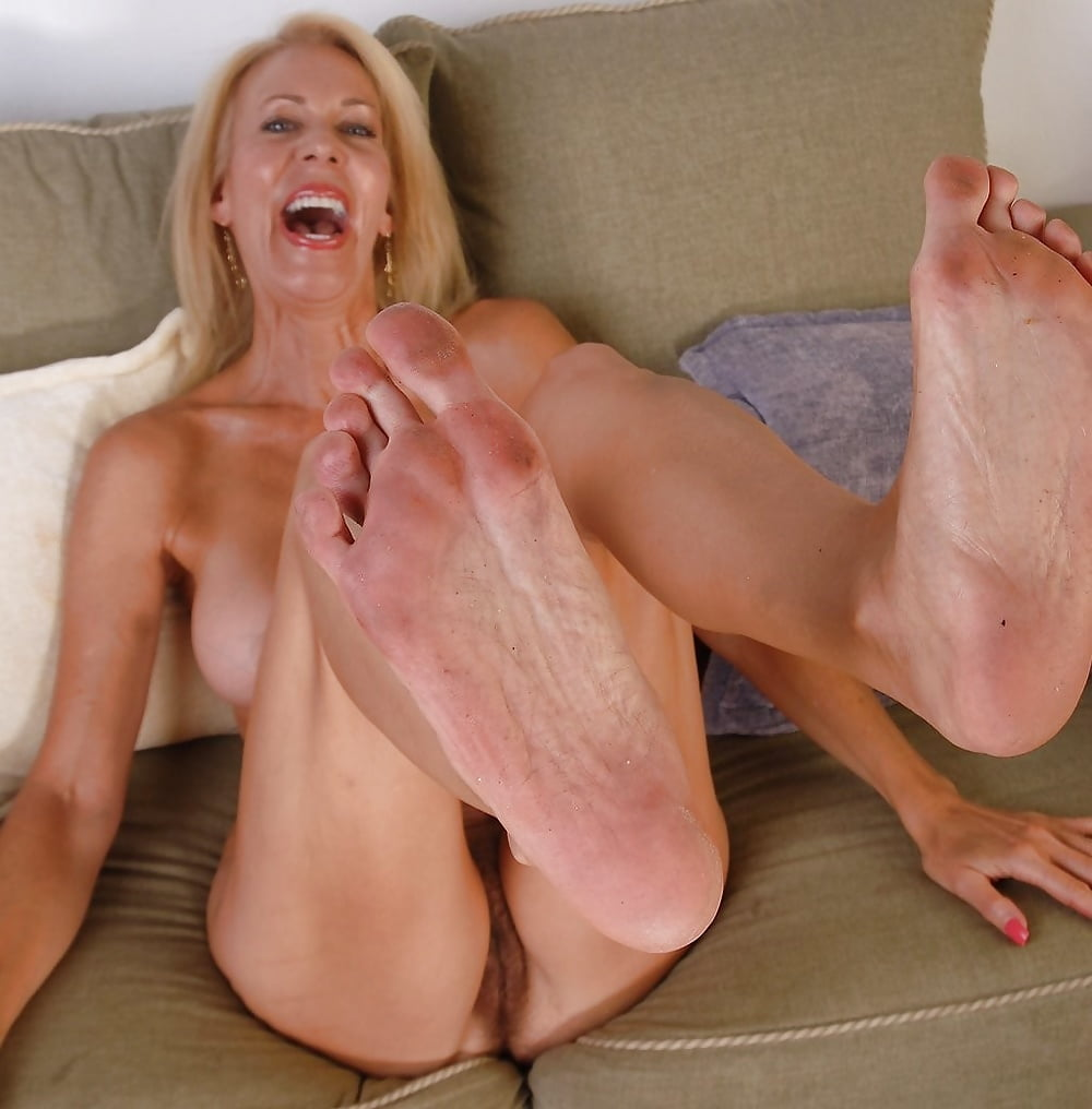Dirty barefoot feet mature