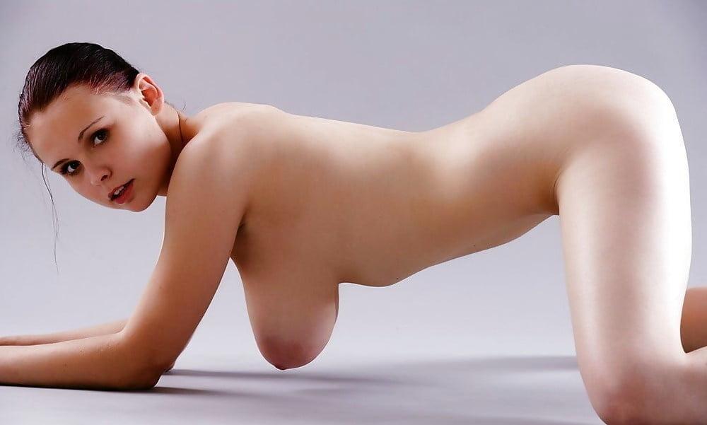 Nude Woman Kneeling On The Floor Stock Image