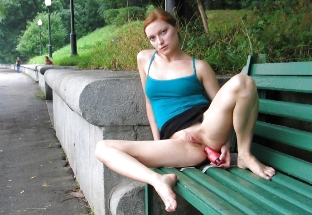 Showing her anal dildo in public 14