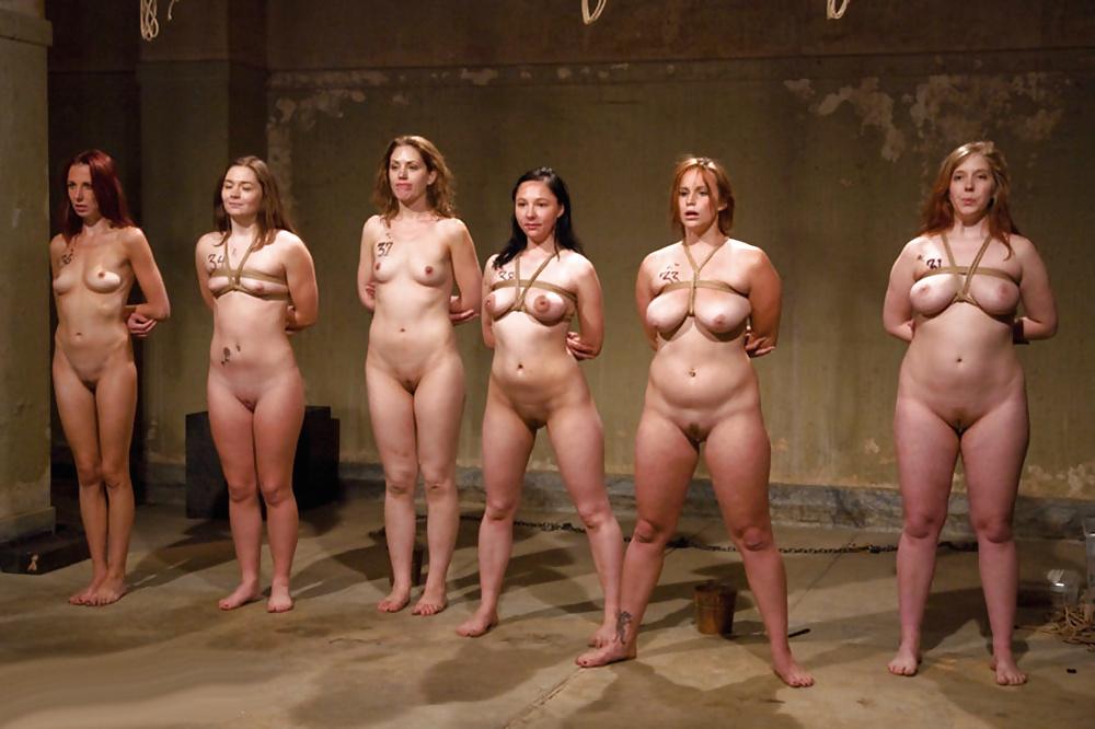 Naked female slaves abused