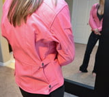 Hot lady showing off a pink motorcycle jacket