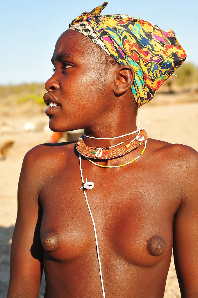 Teenage arbore girl with naked breast and beaded necklace omo valley ethiopia