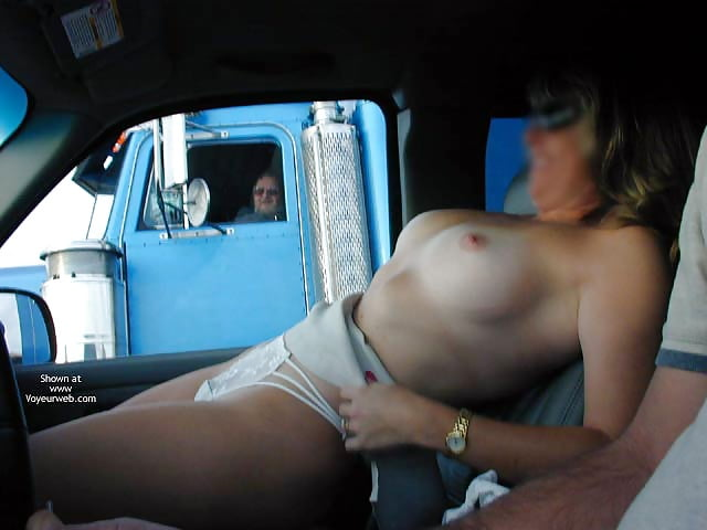 Riding with my tits out and waving to truckers