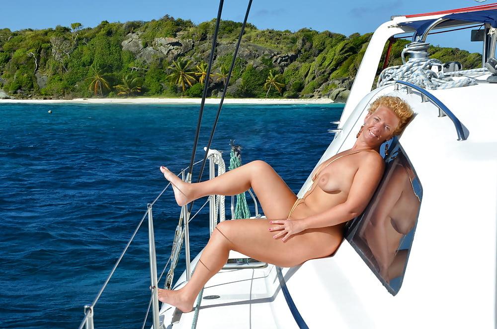 Nude women on a boat
