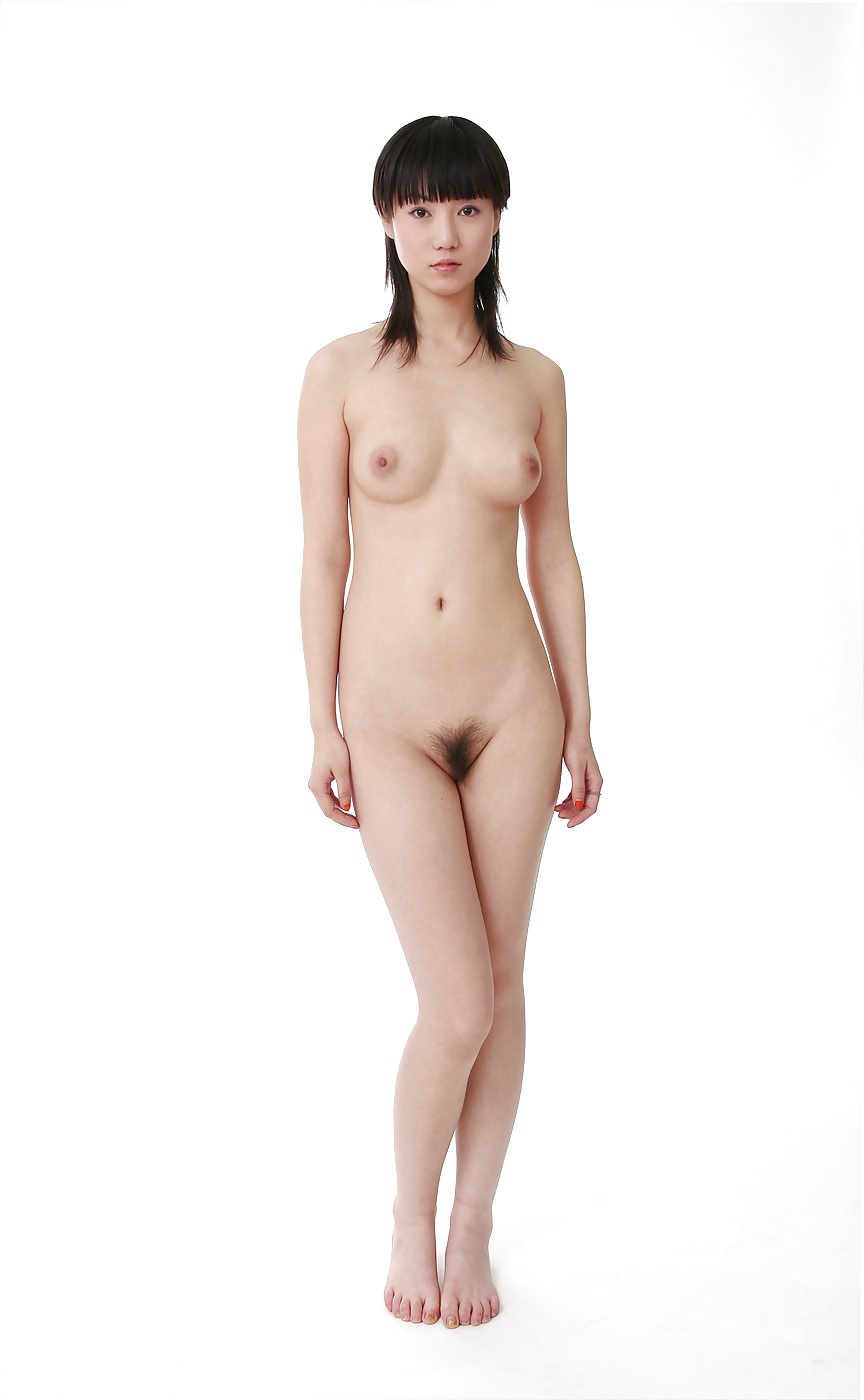 Erotic Nude Asian Model Standing For Photo