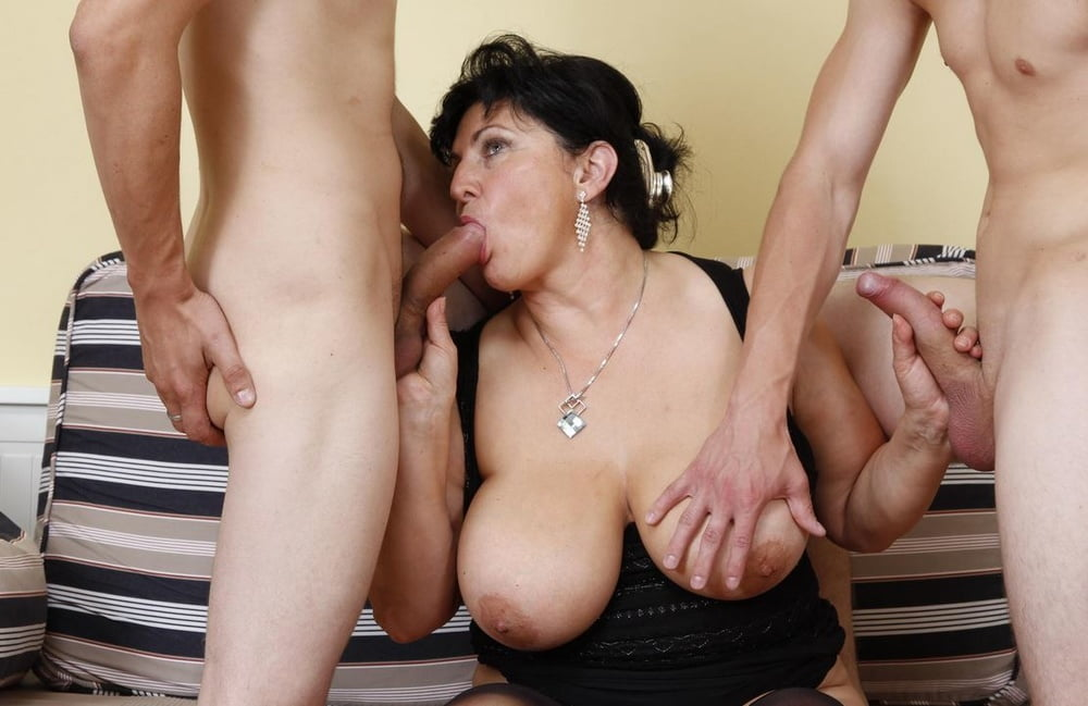 Naughty busty mature milf trying to fuck two young boys