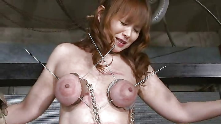 Pushing skewers through my wifes tits
