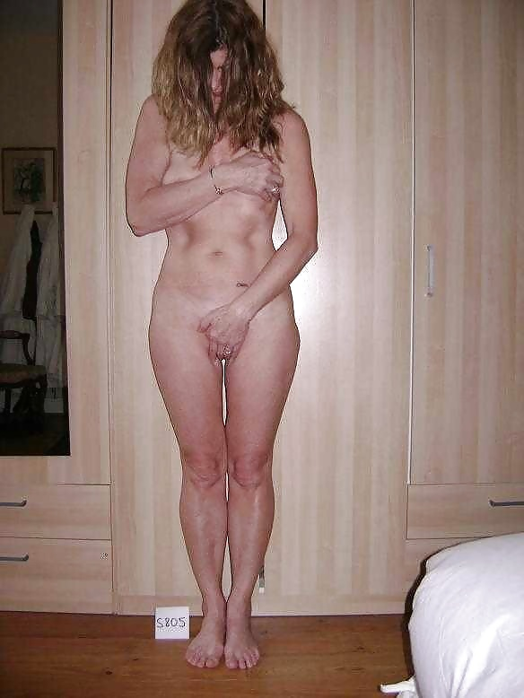 And young embarrassed mature woman naked