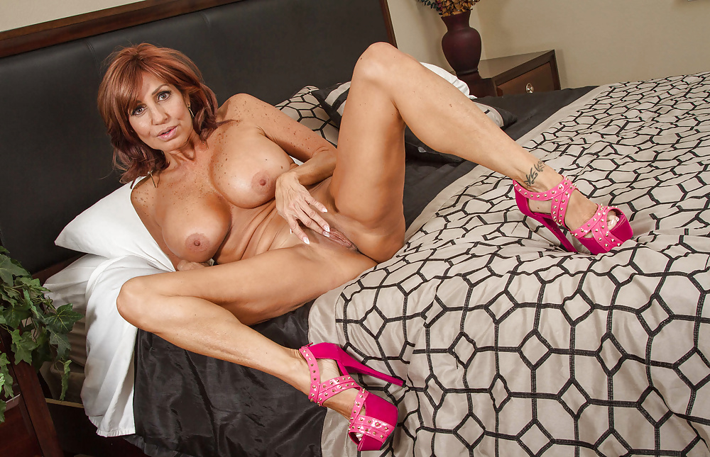 Tara Holiday In Sexy Stockings And Heels Posing On The Bed 1