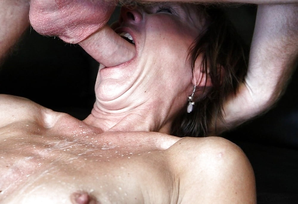 A mature tattooed woman with an extreme deep throat