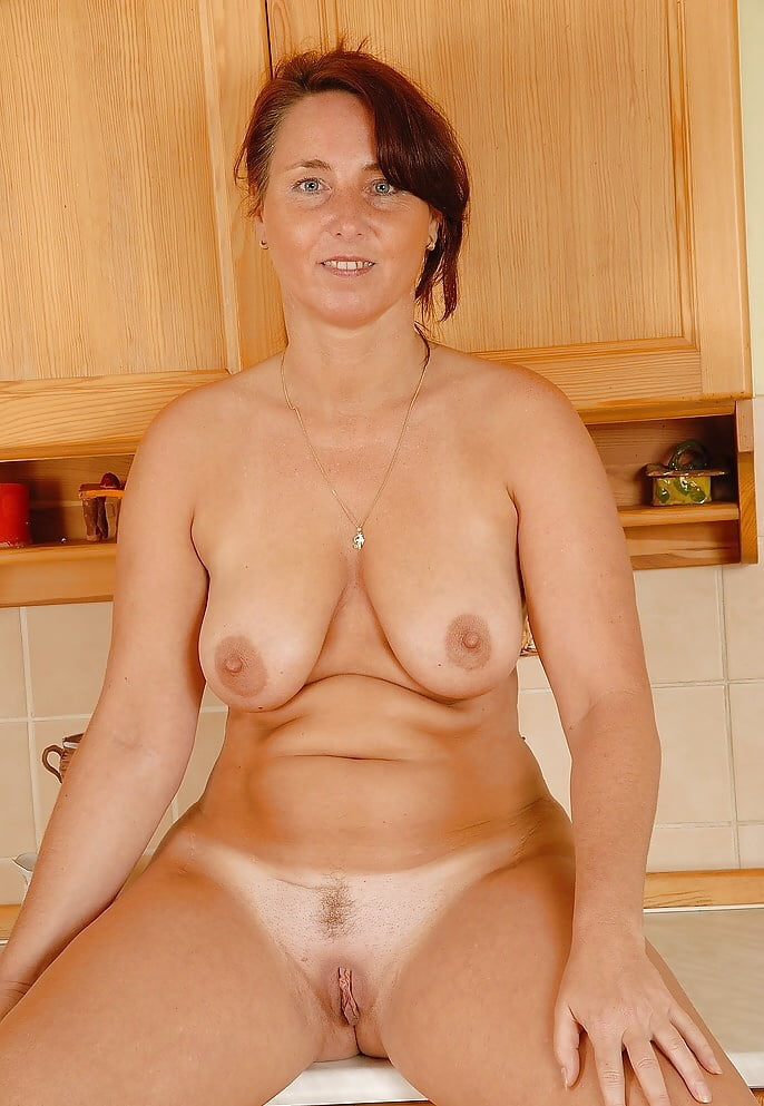 cheeky-nude-milf-donna-reading-nude