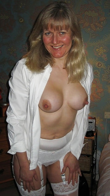 Delicious blonde mature in various sexy poses and outfits - 27 Pics