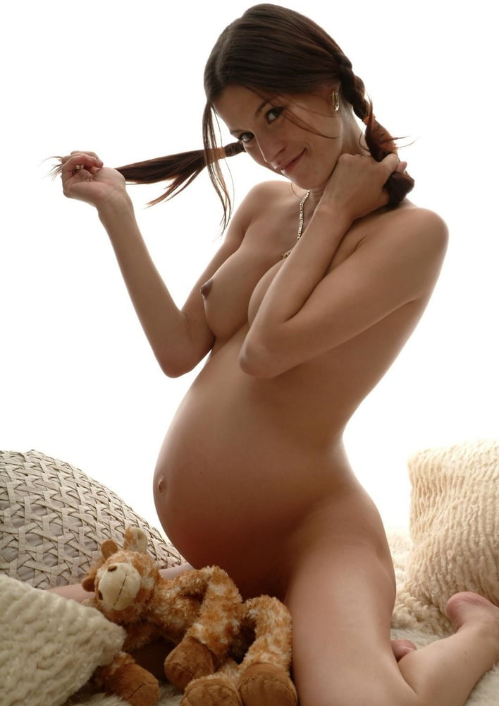 A pregnant girl naked on the floor — img 11