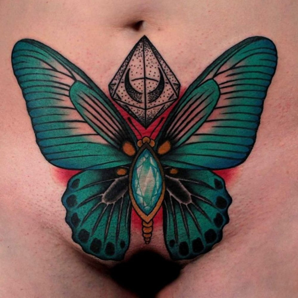 Lewd slut with a butterfly tattoo on her pussy just loves anal sex