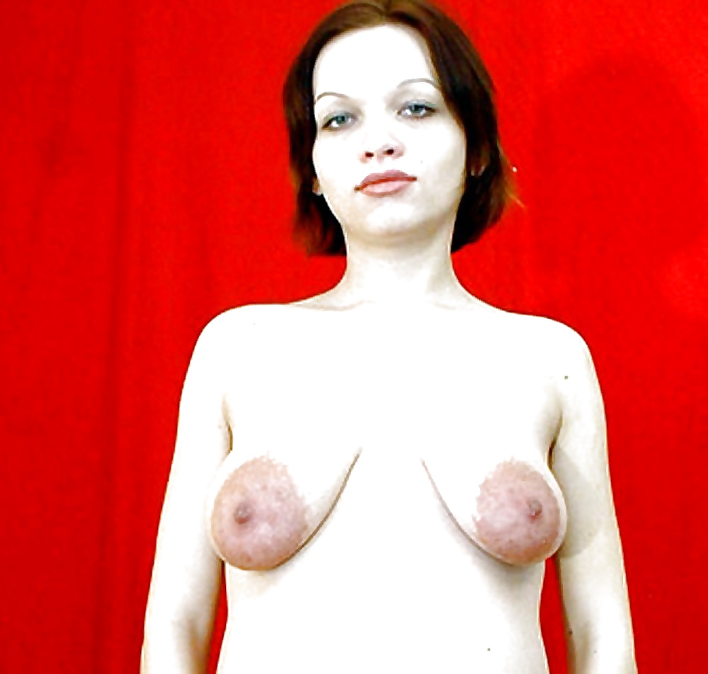 Watch oiling her saggy tits and nips