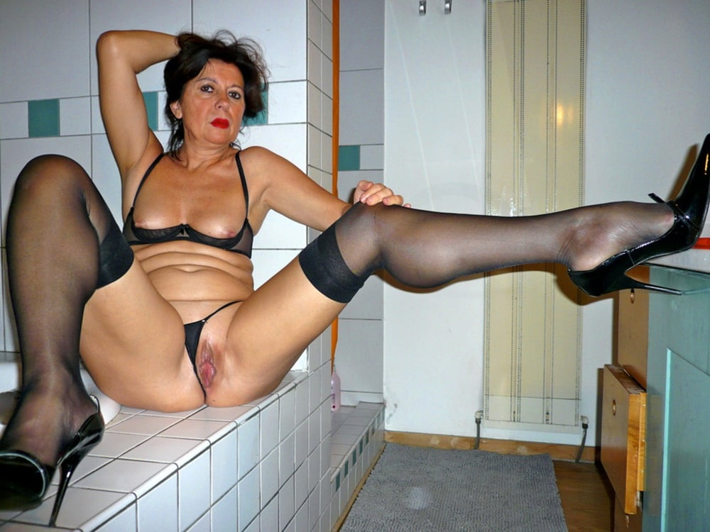 Housewife Tricia's Striptease In Nylon Stockings Suspenders Nylons Parade