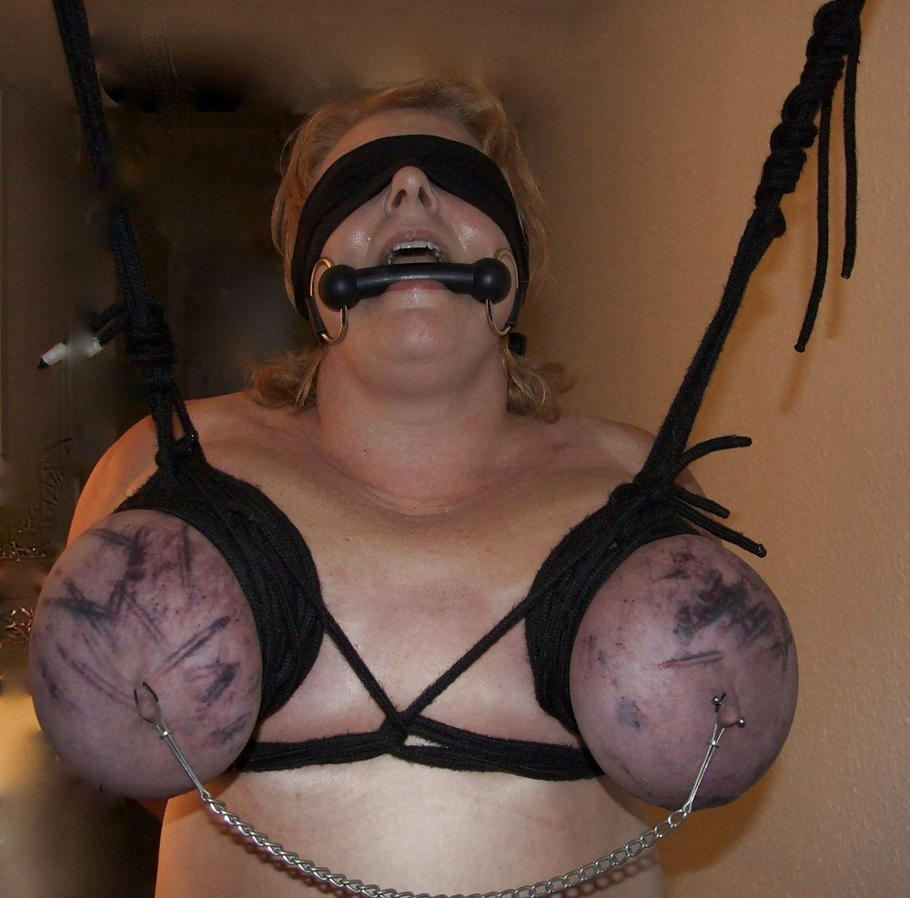 Redhead tied in rope in various positions in bondage punishment photo