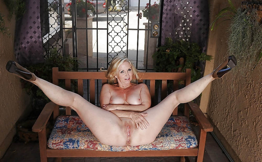 Older milf spreading legs
