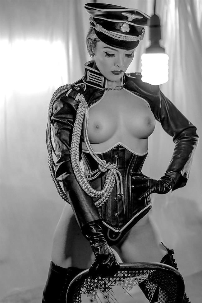Sexy blonde nude nazi in high boots