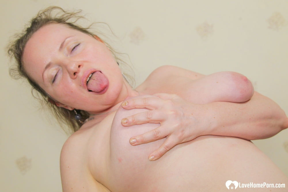 Lusty MILF loves licking her big tits - 15 Pics