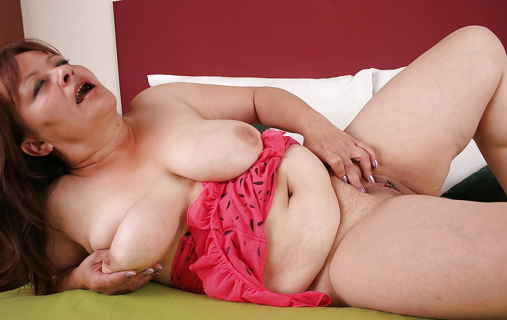 Acute mature whore plays with her titties