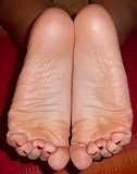 Yummy small feet ready for footjob