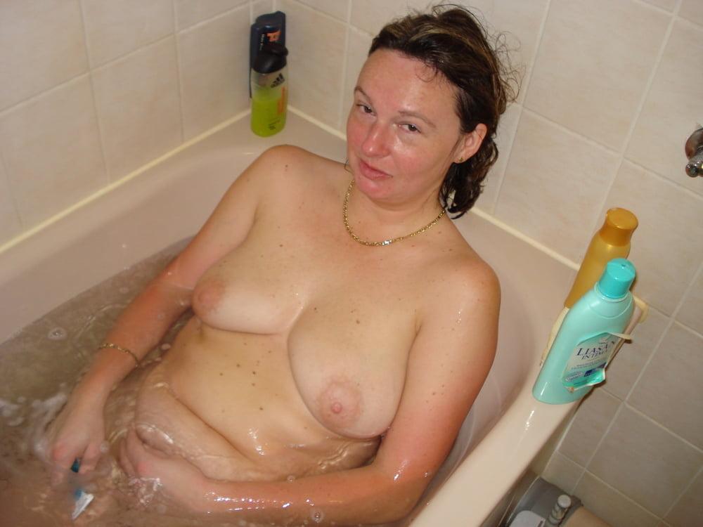 Nude fat girl laying in a bath